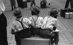 Suspenders worn by kids. Notice the rear clip has snapped off the pants of the kid on the right. However, because he is wearing X-back suspenders, he is still fine. If he was wearing Y-back braces, his pants would start to slip.