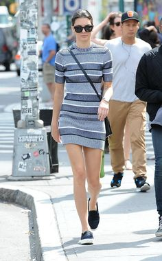 Kendall Jenner's striped sweater mini dress and slip-on shoes