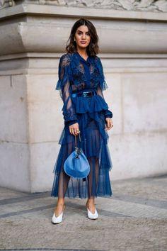 Camila Coelho wears a blue mesh lace dress a blue bag outside Elie Saab during Paris Fashion Week Womenswear Spring/Summer 2018 on September 30 2017...