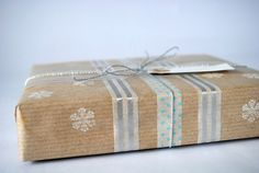 Hand stamped kraft paper + Washi tape + string. So lovely. Comes from the Torie Jayne Blog. http://toriejayne.blogspot.com/2011/01/my-gift-wrapping.html