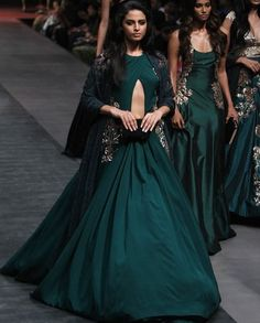 teal green plain lehenga with cut out jacket style choli