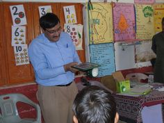 """The gift of solar lights was given to each of the PEP schools in rural Sindh. Instructing how to use the """"Roshni"""" Solar lights. Solar Lights, Beautiful Children, Schools, Education, Learning, Gift, Beautiful Kids, Solar Lanterns, School"""