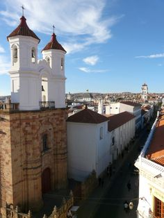The Convent of San Felipe de Neri in Sucre, Bolivia,and a picture that captures the streets of the center of the city.