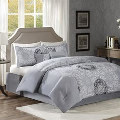Elegance and style come together in this Tatum 7 Piece Comforter Set by Madison Park.  The layered medallion motif is embroidered and printed down the middle of the comforter can be seen repeated on the two shams.  Embroidery and fabric details used in the three decorative pillows give extra dimension to this beautiful collection.  Set includes a dark grey bedskirt.