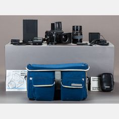 LOT 206 HASSELBLAD CAMERA EQUIPMENT Est: $3,000-5,000 Description A Collection of Hasselblad Camera and Equipment, 20th Century, Including a Hasselblad 503CX camera, a Hasselblad Wide Angle 60mm f3.5CF Zeiss Distagon T* Lens, a Hasselblad Telephoto 150mm f4CF Zeiss Sonnar T* Lens, Hasselblad A12 Film Back, Hasselblad Polaroid back, Hasselblad Quick Release Lever mount for tripod, Gossen multi-pro light and flash meter, two Hasselblad lens shades, two UV filters, Hasselblad Camera Strap and…