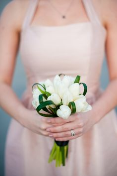 Simple white tulips bouquet from Nick & Mackenzie's intimate, Washington DC elopement. Images by Rebekah Hoyt Photography.