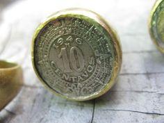 Anillo sello talla 56, con diseño de moneda de 10 centavos.