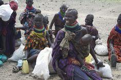 Turkana women smile after receiving much needed food by servinternational, via Flickr