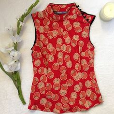 """HALE BOB Asian Inspired Silk Top It was love at first sight! I love this delicate and stunning top from Hale Bob! This top boasts a beautiful and intricate mandarin collar with knotted buttons to the sleeve, rounded hem, and sheer back. 100% silk. Dry clean only. Approx flat measurements (top runs small, but the material is easy to stretch) 7.5"""" collar 14.5"""" shoulder to shoulder 16.5"""" bust 15"""" waist 23"""" length. Excellent used condition! Hale Bob Tops"""