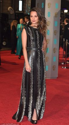 What an entrance: Alicia Vikander looked incredible in a silver embellished leather gown a...