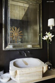 ABOVE An outdoor swing from Southeastern. Black Powder Room, Powder Rooms, Silver Ceiling Fan, Mountain Brook, Cottage Renovation, Modern Cottage, Bathroom Light Fixtures, Black Doors, Blue Walls