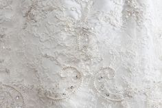 Unique and distinctive  fabrics, laces, embroideries,  and appliques require special  care, as do pearls, beads,  sequins and droplets.  #weddinggown #details #sequins #beads #pearls   @Donna Anne Gagliardo