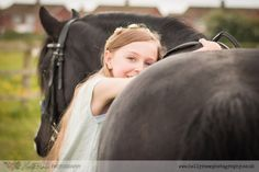 Horse portrait session, My Horse and Me. Girl hugging black Welsh Section D Pony