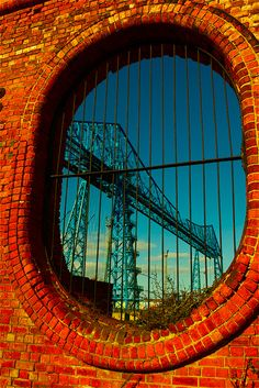 The Transporter viewed through the Vulcan Street Wall, a small section of which is still standing from the old Cleveland Salt Works built in Bridge Builder, Love Bridge, Stockton On Tees, North East England, Middlesbrough, School Photography, North Yorkshire, Covered Bridges, Cleveland
