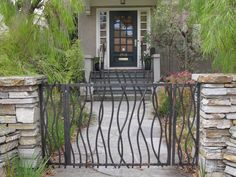 Usually metal gates seem so clunky and heavy but this one lends a soft, wispy feel to the entrance.