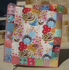 This quilt was made with Ann Marie Horners newest fabric line LouLouThi for Westminster Free Spirit Fabrics. This adorable quilt includes pink,