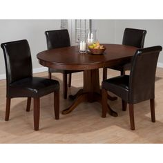 Create a beautiful, traditional-style gathering place in your dining room with the Jofran Hartland 5 Piece Dining Table Set with Black Chairs.