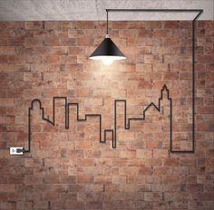 Industrial Stil mit Backstein Tapete und interessanter Gestaltung mit dem Kabel der Leuchte