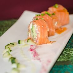Smoked Salmon Rolls with cucumber, red onions and avocado