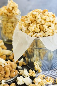 A sweet and salty treat that takes minutes to make! Skinny Peanut Butter Caramel Popcorn is made with only natural ingredients and is tossed with cashews and white chocolate for a sweet treat! Popcorn Snacks, Flavored Popcorn, Popcorn Recipes, Snack Recipes, Popcorn Bowl, Fun Easy Recipes, Sweet Recipes, Peanut Butter White Chocolate, Yummy Treats