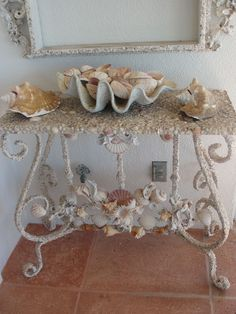 Shell art table--Oh, what a great piece to go in  my (future in my dreams) beach house or garden room...