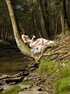 "Maybe it's the setting in the forest or the creek that reminds me of my Gram's house, but I love this picture: ""Girl Reading in a Forest"""