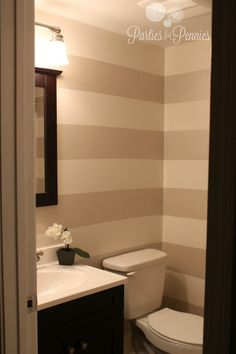 striped bathroom.