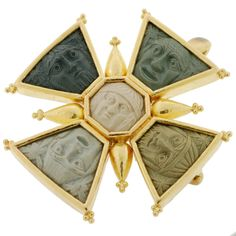 A fabulous signed lava cameo pin/pendant by Elizabeth Locke! This unique and interesting piece is made of 18kt yellow gold and features a maltese cross design with 5 lava cameos set inside. Each cameo is unique and depicts a face, some which have a look of surprise, and all appear to be inspired by an ancient Greek or Roman man. The vibrant 18kt yellow gold makes a lovely contrast to the cameos, and extending out from each side of the maltese cross is a gold urn.