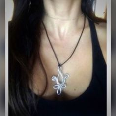 """NEW YEAR SALE CHARM NECKLACE HANDMADE - Silver FLEUR DE LIS style necklace.  Made from lightweight flexible tarnish resistant wire.  Comes with black approx 16"""" black leather cord. Passions23 Jewelry Necklaces"""
