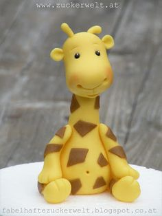 Fondant Giraffe Step-by-Step TutorialExplanations on how to make different flowers, animals etc. (Baking Cakes How To Make) Why not use the world's best air dry clay and make it easy. Fondant Giraffe, Giraffe Cakes, Safari Cakes, Giraffe Baby, Fondant Toppers, Fondant Cakes, Cupcake Cakes, Baby Cakes, Decors Pate A Sucre
