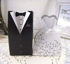 I found some amazing stuff, open it to learn more! Don't wait:https://m.dhgate.com/product/new-100pcs-bride-and-groom-candy-boxes-wedding/193046530.html