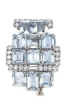 An art deco aquamarine and diamond brooch, by Cartier, circa 1930 Of geometric design, set with step-cut aquamarines, highlighted with baguette and brilliant-cut diamonds, diamonds approx. 0.95ct total, pin signed Cartier Paris, maker's mark SCA, numbered, French assay marks, length 3.3cm