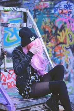 The black outfit really contrasts nicely with the pink hair.