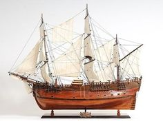 New Model Ship Product DetailsDimensions (inches):32H x 13W x 38LComment:Our captivating HMS Endeavour model is handcrafted from beautiful wood such as rosewood, mahogany, teak, and along with various