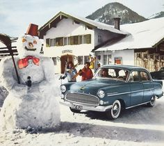 1955-1958 Opel Kapitän Tragedy is about to happen. We will never know why this Kapitän driver wanted to run over a snowman. Right in front of the Kurhaus nonetheless! And look at the gold colored badge...