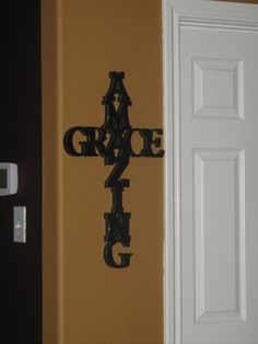 Letters from Hobby Lobby, painted and arranged into Amazing Grace in the form of a cross :) Wish there was instructions of how to do this! I tried it and it turned out okay, but wondering if I could have made it sturdier?