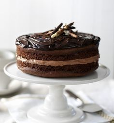 This fantastically fudgey chocolate cake is rich, moist and treacly with a glossy ganache finish - The Best of The Great British Bake Off