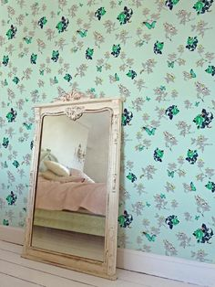 Paradise blue butterflies make this floral-patterned wallpaper stand out. (http://www.hgtv.com/walls-doors-and-floors/20-vintage-wallpaper-ideas/pictures/page-17.html?soc=Pinterest)