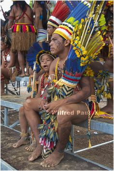 """Father and Son Watching the  """"XII  Jogos dos Povos Indigenas"""" em Cuiabá. Mato Grosso, Brazil"""