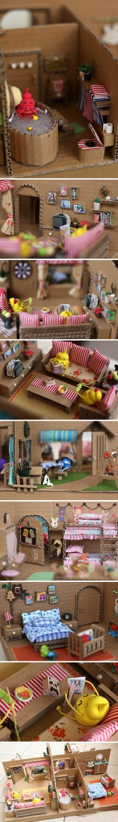 Adorable dollhouse made from cardboard boxes and odds and ends.