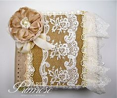 Beautiful burlap and lace album. See it at http://www.paperprimrose.com/2013/05/lots-of-lace-pearls/ Blog gives description and shows page by page complete with photographs.