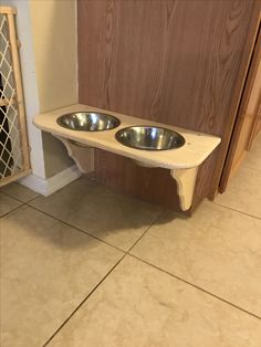 Raised and mounted dog food bowl that my husband made!