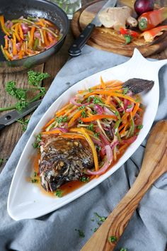 Filipino Sweet & Sour Fish Make this colorful, tangy-sweet Filipino Escabeche or Sweet and Sour Fish and bring your plain fried fish to the next level of goodness. Fish Escabeche, Escabeche Recipe, Fish Recipe Filipino, Filipino Recipes, Filipino Dishes, Asian Recipes, Seafood Dishes, Seafood Recipes, Vegetarian Recipes