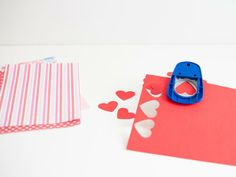 Punch Out Hearts - How to Make a Valentine's Day Paper Heart Garland on HGTV