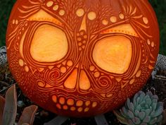 This decorative pumpkin skull captures the festive spirit of Dia de los Muertos - The Day of the Dead! | DIY Halloween Pumpkin Carving Etching Inspiration | http://www.hgtvgardens.com/