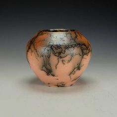 Raku Pottery with horse hair.  Orange Terra Sigillata hand