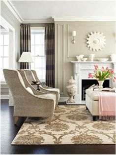 White is, and always will be a classic color to decorate with.  It can as easily be used in traditional décor as in contemporary.  You can see in the photos below that white can still be warm and color is not always necessary to make an interesting and inviting home. The dark trim adds drama and punch in this home.  The furnishings...