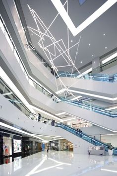 Interior shot of the Chinese shopping centre with a faceted and colour-changing facade.