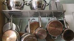 Save precious space in your kitchen. Find out how to make your own DIY hanging pot rack using one of these cheap and easy methods. Pot Rack Hanging, Hanging Pots, Diy Hanging, Hanging Storage, Vertical Storage, Kitchen Organization, Kitchen Storage, Kitchen Decor, Kitchen Design