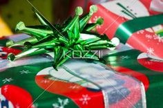 close-up shot of a christmas gift box with shiny decoration. - Detailed shot of a Christmas present with green shiny decoration.
